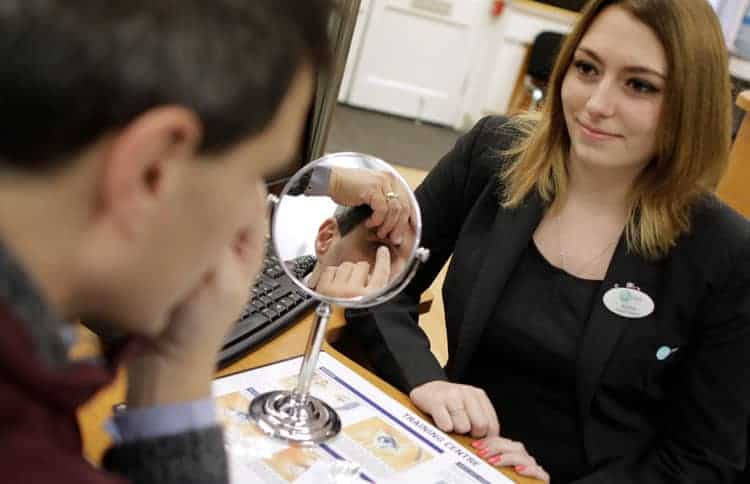 Patient fitting contact lenses in Newark shop