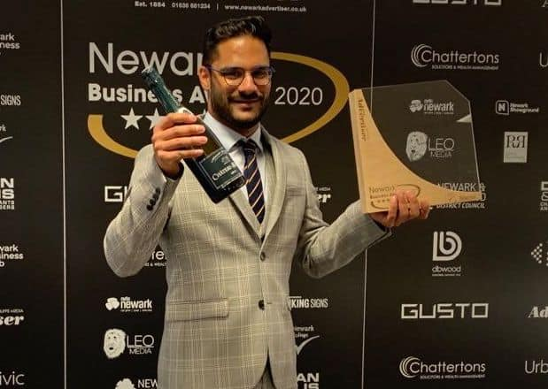 Shaimil with the customer care award from newark business awards